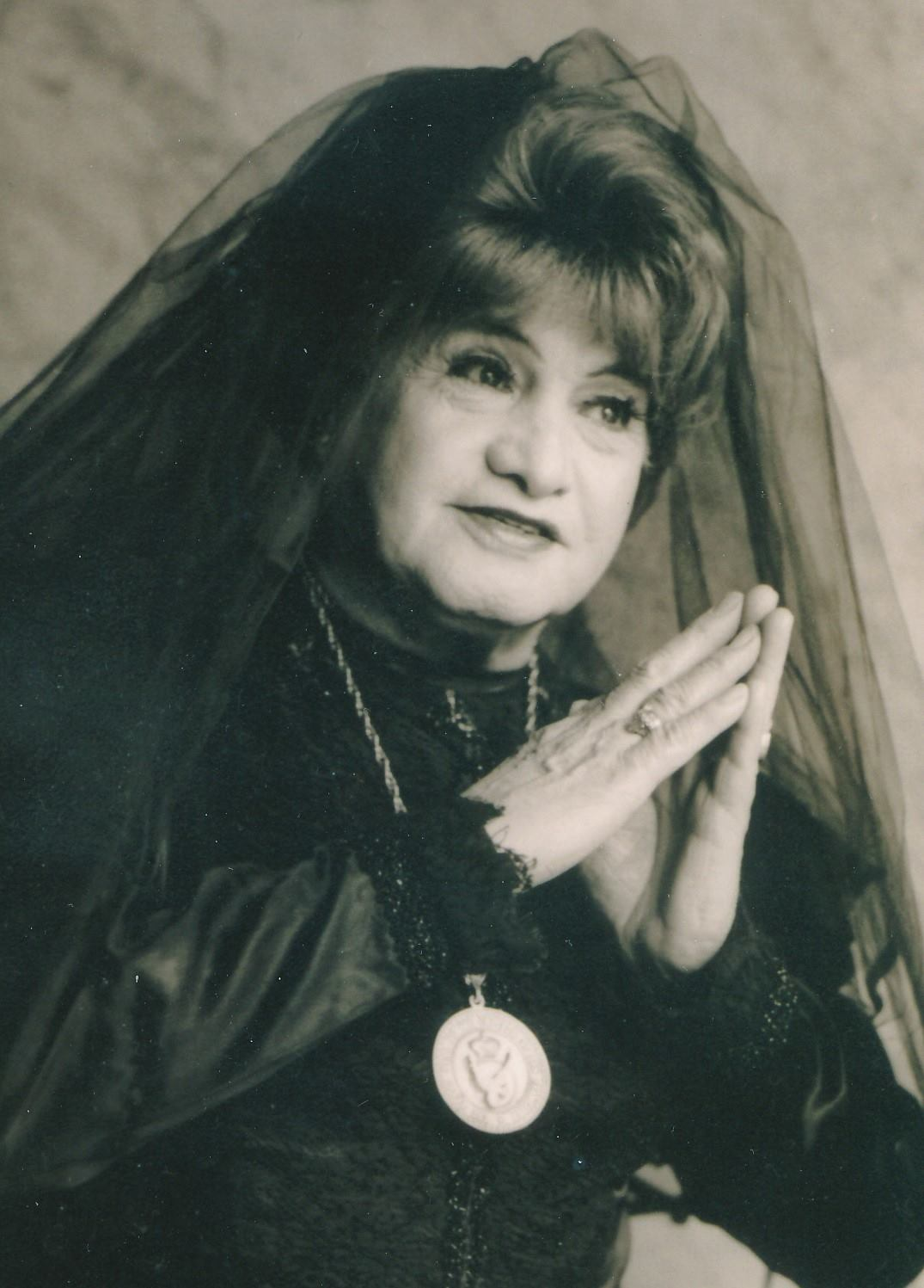 Josa Sarria as the Widow Norton