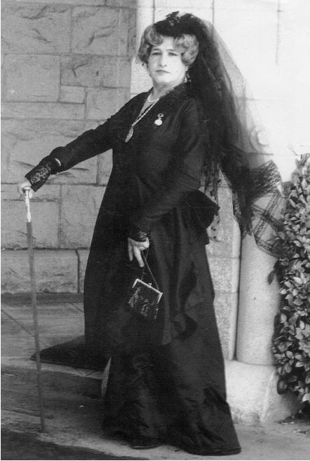 Widow Norton Jose in black dress